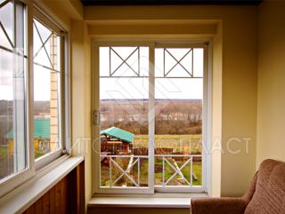 Остекление лоджии раздвижными окнами